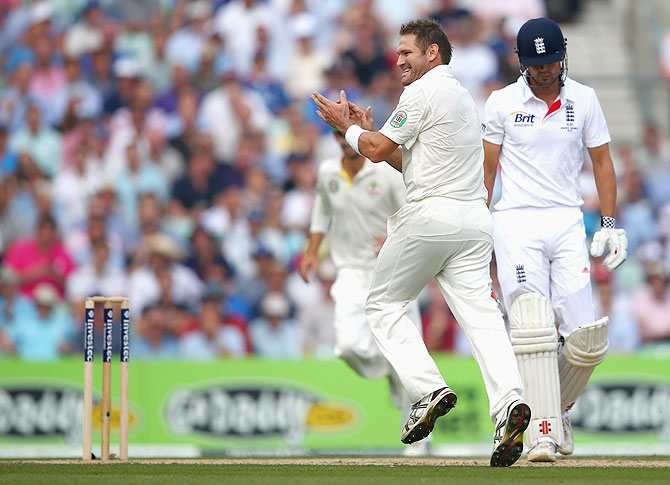 Ryan Harris of Australia celebrates after taking the wicket of Alastair Cook of England on Friday