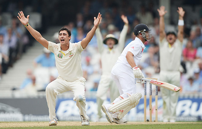 Mitchell Starc of Australia appeals successfully for the wicket of Jonathan Trott on Day 3 of the 5th Ashes Test on Friday
