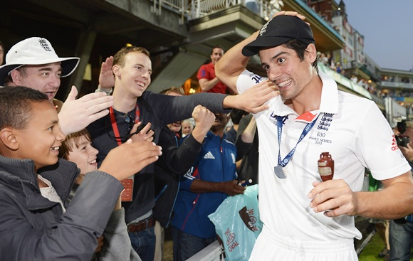 Alastair Cook of England celebrates with fans