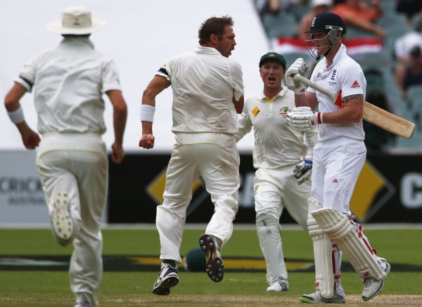 Australia's Ryan Harris (C) reacts at England's Ben Stokes after taking his wicket during the fourth day's play in the second Ashes cricket Test