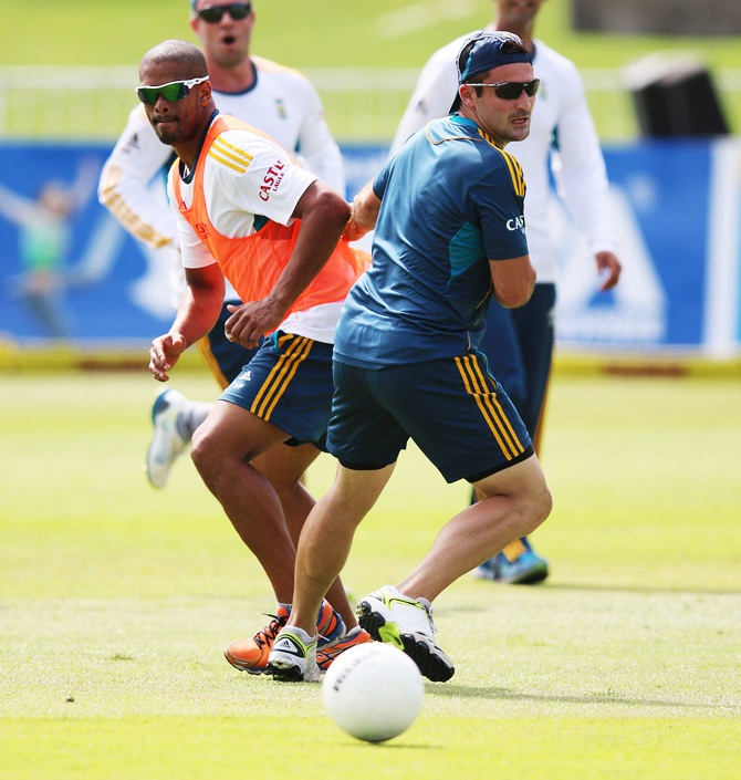 Vernon Philander and Dean Elgar (right) of South Africa during the South African national cricket team training session