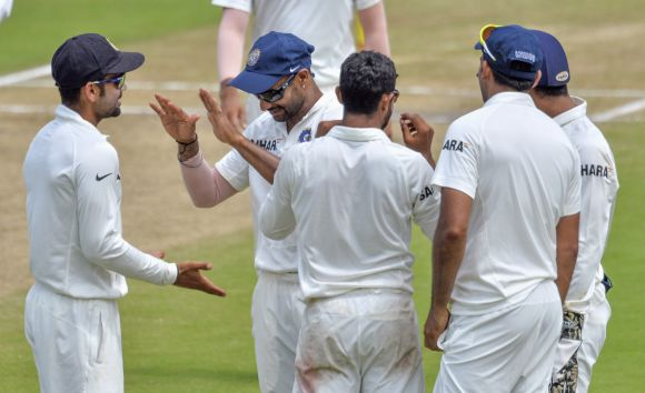Indian players celebrate after dismissing AB de Villiers