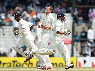 Australia's Peter Siddle looks on as India's Cheteshwar Pujara and Sachin Tendulkar steal a run on Day 2 of the 1st Test at the MA Chidambaram Stadium in Chennai on Saturday