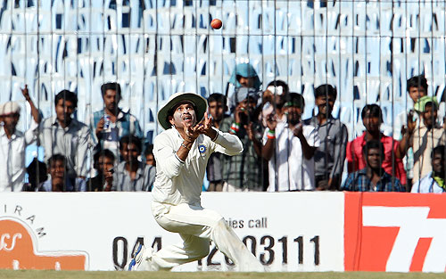 Sachin Tendulkar takes the catch to dismiss Mitchell Starc