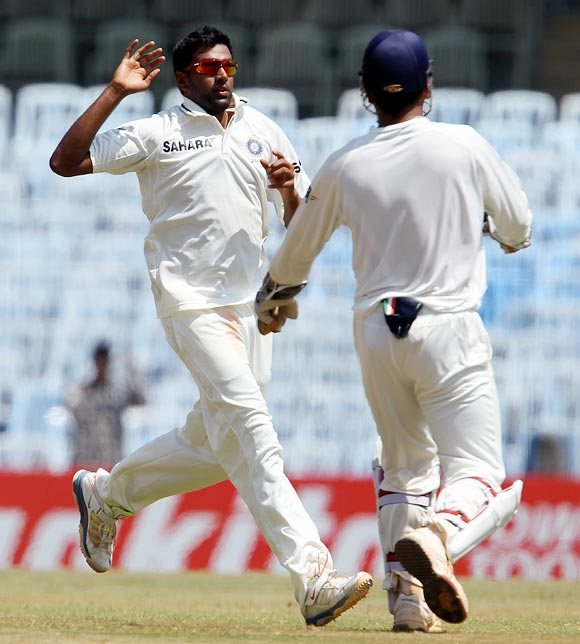 Ravichandran Ashwin celebrates with captain Dhoni after taking the wicket of Shane Watson