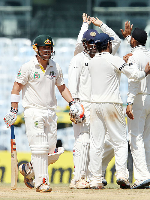 David Warner walks off the field after his dismissal as the Indian team celebrates