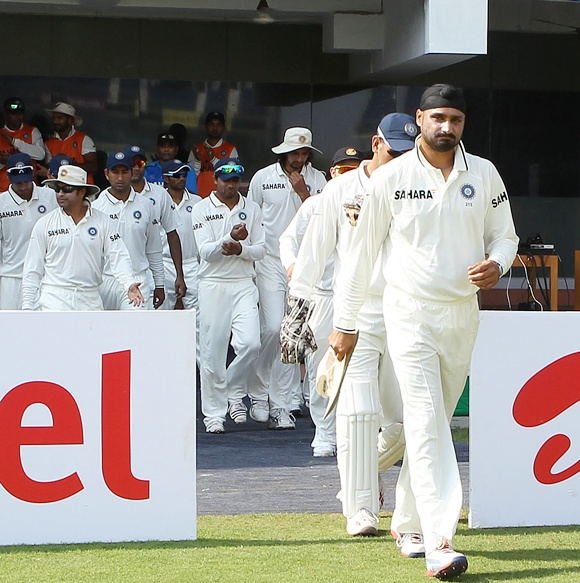 Harbhajan Singh leads the Indian team out on the field on Day 1 of the 1st Test