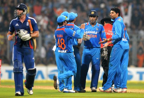 Indian players celebrate after a fall of England wicket