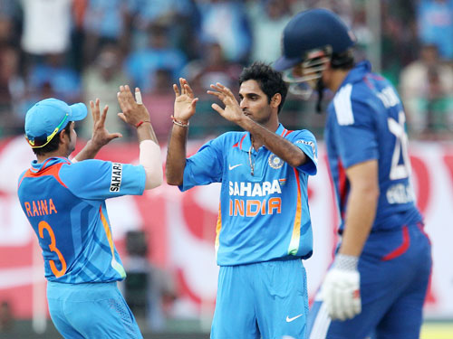 Bhuvneshwar Kumar celebrates after bagging the wicket of Alastair Cook
