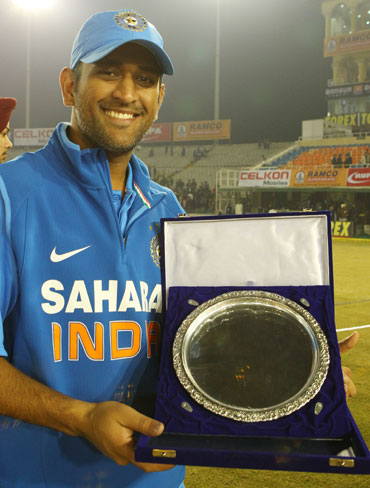 MS Dhoni poses with the match plate after the 4th ODI between India and England at the PCA Stadium, Mohali