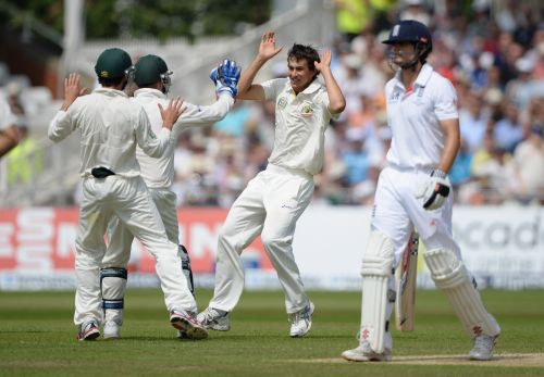 Ashton Agar celebrates after claiming the wicket of Alastair Cook
