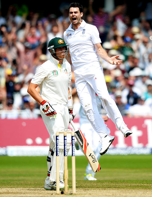 James Anderson celebrates as Peter Siddle walks back after his dismissal