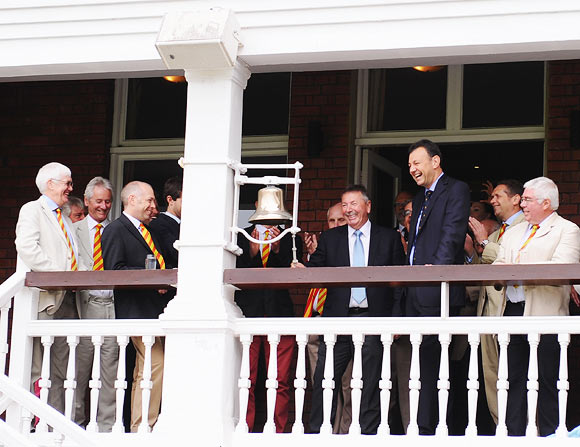 Australian selector Rod Marsh (centre) rings the bell prior to start of day three at Lord's