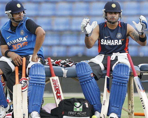 India's captain Virat Kohli (right) and Suresh Raina