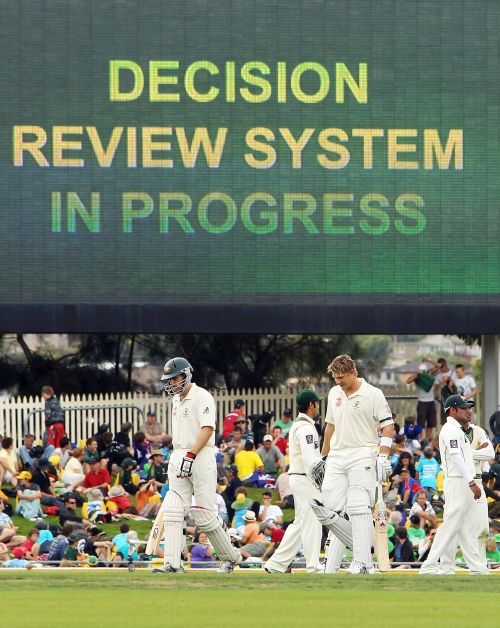 Players wait for the decision review system