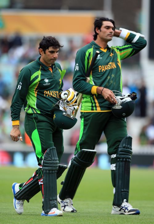 Misbah-ul-Haq and Mohammed Irfan of Pakistan walk off at the end of the innings during the ICC Champions Trophy group B match