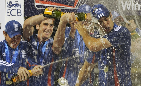 England's captain Alastair Cook has champagne poured on him
