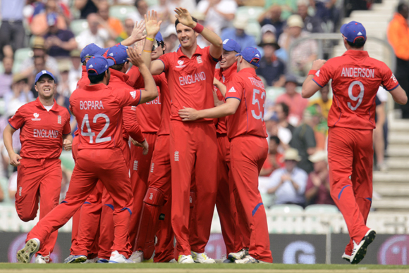 England's Steven Finn (4th R) is congratulated after dismissing South Africa's Hashim Amla during the ICC Champions Trophy semi final