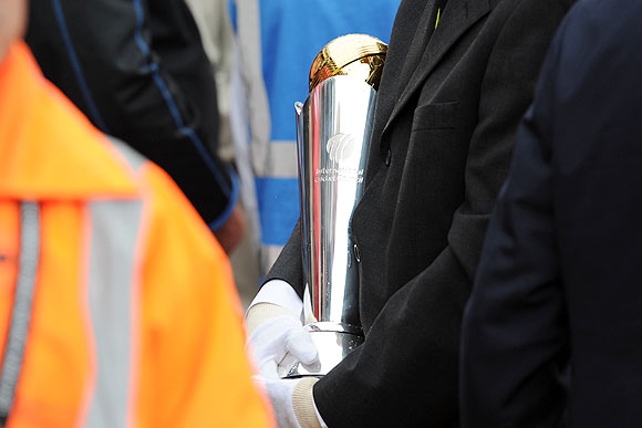 The ICC Champions Trophy is carried off the pitch