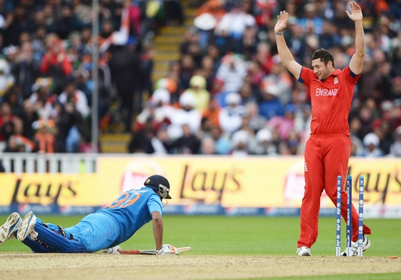 Tim Bresnan of England celebrates the run out