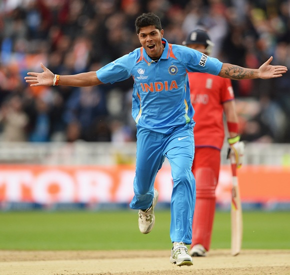 Umesh Yadav of India celebrates the wicket of Alastair Cook
