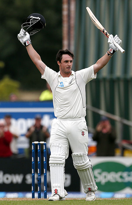 Hamish Rutherford celebrates after scoring his debut century against England on Friday