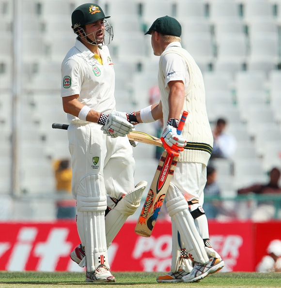 Ed Cowan congratulates David Warner on his fifty