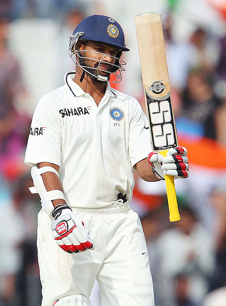 Shikhar Dhawan celebrates on completing 150 runs in Mohali on Saturday