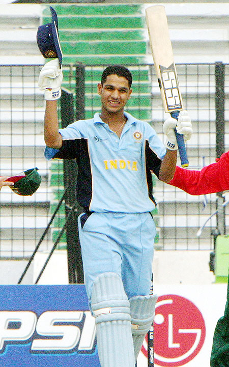 Indian batsman Shikhar Dhawan acknowledges the crowd after scoring a century against Bangladesh in the Under-19 cricket World Cup match in Dhaka on February 20, 2004