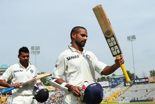 Shikhar Dhawan and Murali Vijay acknowledge the cheers from the Mohali crowd after their record opening stand, March 16, 2013. Photograph: BCCI
