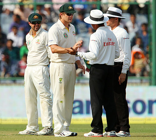 Shane Watson has a chat with umpire Aleem Dar