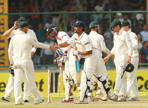 Team India celebrates the fall of an Australian wicket