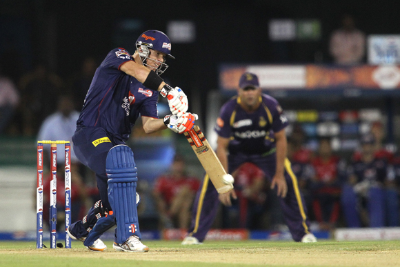 David Warner of Delhi Daredevils drives a delivery through to the boundary
