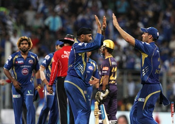 Mumbai Indians players celebrate after victory over Kolkata Knight Riders