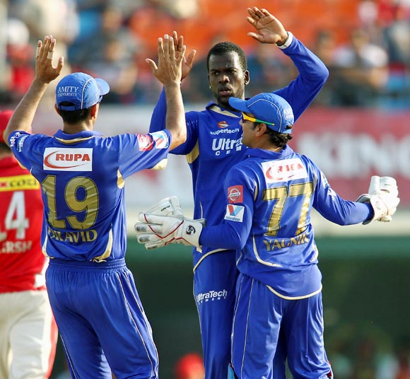 Kevon Cooper celebrates with team mates after getting the wicket of Shaun Marsh