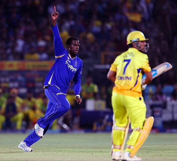 Kevon Cooper celebrates the wicket of Mahendra Singh Dhoni