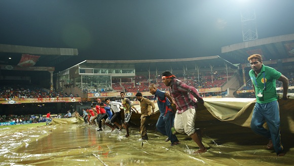 PIX: Fans frustrated as rain plays spoilsport in Bangalore