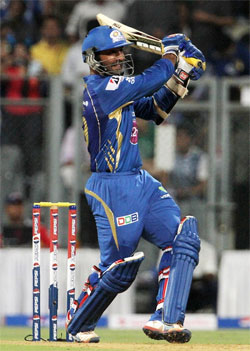 Karthik fined for showing dissent