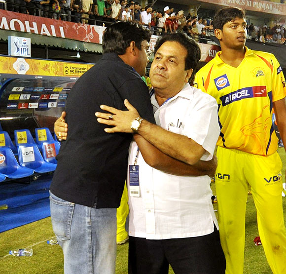 Chennai Super Kings CEO Gurunath Meiyappan (left) hugs IPL chairman Rajeev Shukla