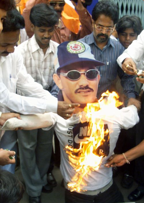 Protesters set fire to an effigy of Mohammad Azharuddin who was banned for life following the match-fixing scandal in 2000