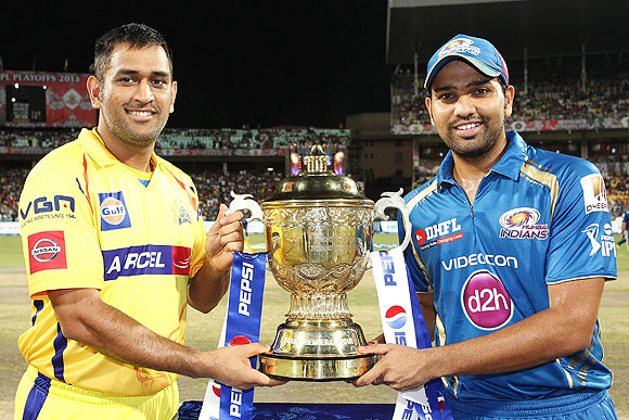 Mumbai Indians captain Rohit Sharma and CSK captain MS Dhoni with the IPL trophy before the match