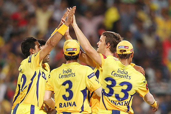 Ravindra Jadeja congratulates Albie Morkel after he took the wicket of Rohit Sharma