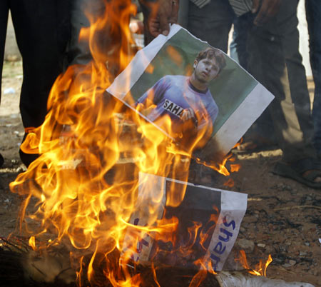 Demonstrators burn a poster of S Sreesanth during a protest in Ahmedabad