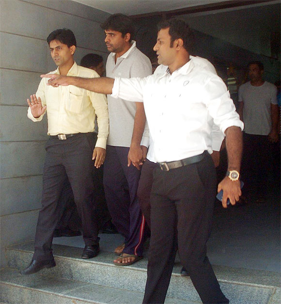 Gurunath Meiyappan, the former Chennai Super Kings CEO, centre, being produced in a Mumbai court, May 31.