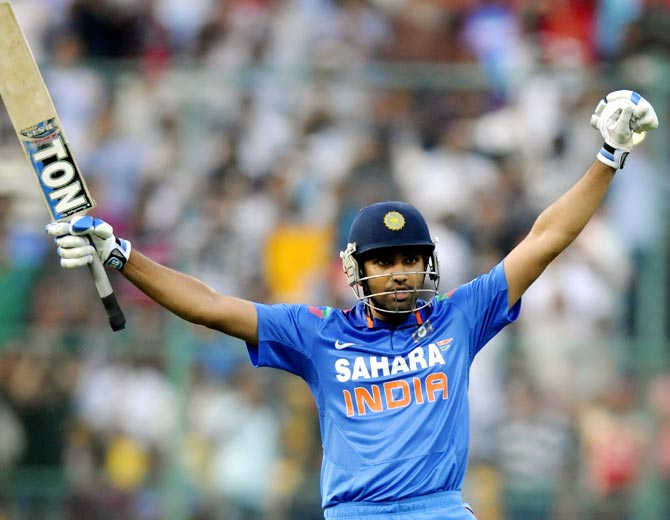 Rohit Sharma celebrates after reaching his century