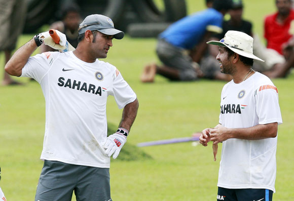 India's captain Mahendra Singh Dhoni (left) and Sachin Tendulkar