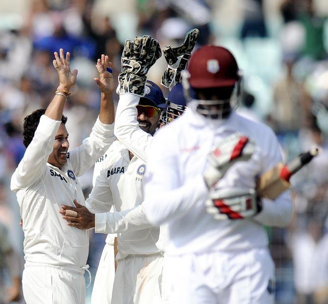 PHOTOS: Tendulkar gets a wicket in his 199th Test!