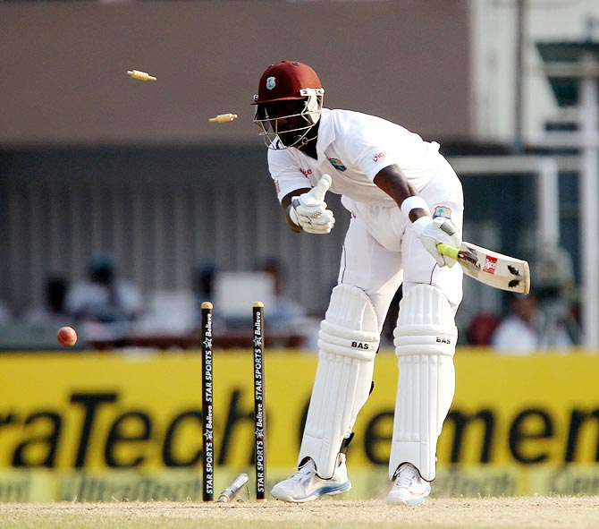Darren Sammy is bowled by Mohammed Shami