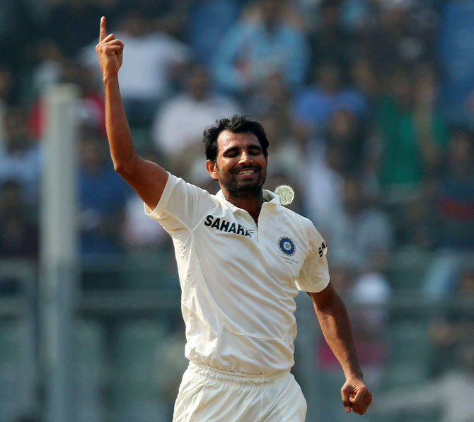 Mohammed Shami celebrates the wicket of Chris Gayle of West Indies