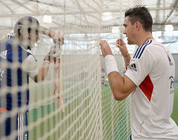 Kevin Pietersen of England speaks with Steven Finn